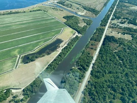 Aerial photo taken April 4, 2020, shows apparent blue-green algae blooms along the western end of the C-44 Canal.