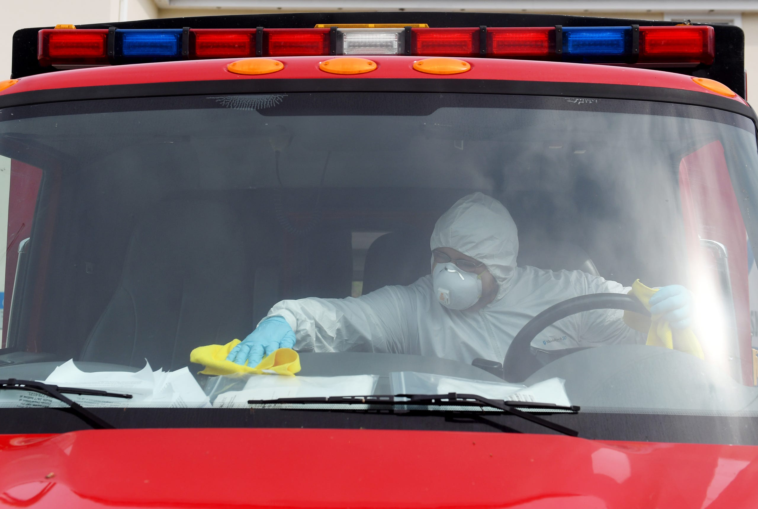 "John Lowie and Rich Danzig, of Jarvis Property Restoration, use a disinfectant spray to clean the two ambulance units of the Indian River Shores Public Safety Department on Tuesday, April 14, 2020, in Indian River Shores. The company comes a few times per week to clean the inside of the units that may have come in contact with someone carrying COVID-19. ""This is a complementary service we are providing for the department and local first responders,"" said Matthew Johns, operations manager with Jarvis Property Restoration. ""We're using a fogging method, which gives us better application of the disinfectant. We're cleaning the inside of rigs and offices, anywhere there are high traffic areas."" Crews from Jarvis are also providing the cleaning service to the Indian River County Sheriff's Office."