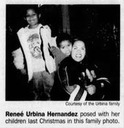 11/05/2006 Renee Urbina Hwernandez posed with her children lasr Christmas in this family photo.