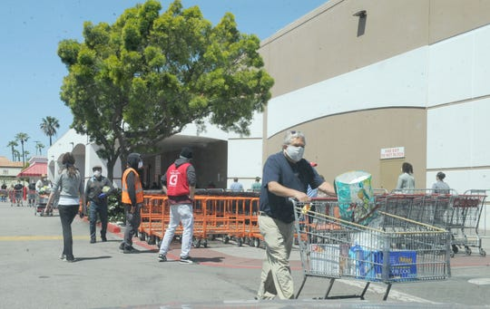 The Costco in Oxnard only let small groups of shoppers into the warehouse at a time. On Tuesday, the line wrapped around the building to the tire center. The County of Ventura extended its health order Tuesday until May 15, ensuring the lines are likely to continue.