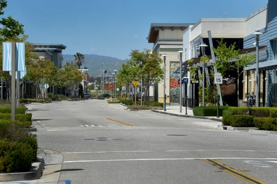 The Collection in Oxnard appeared to be more of a ghost town than a shopping mall Tuesday. The County of Ventura extended its public health order until May 15, leaving most retailers shuttered another month.