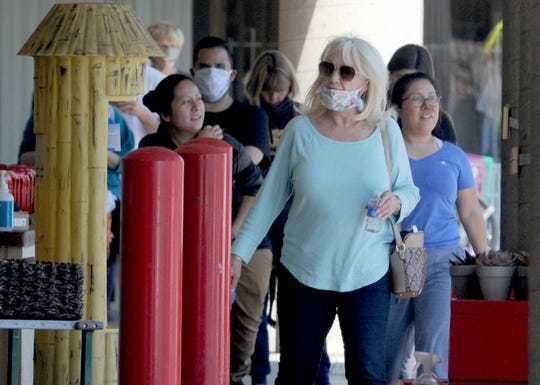 A line of dozens of shoppers queued up at Trader Joe's in Camarillo Tuesday to ensure social distancing in the store. The County of Ventura extended its public health order until May 15, ensuring the lines were likely to continue.