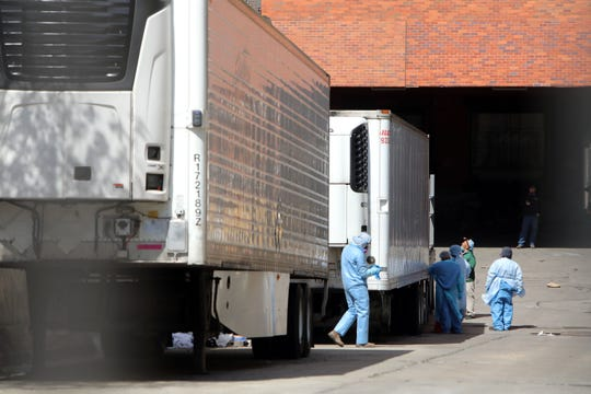 Refrigerated trailers are being used as a makeshift morgue behind Lincoln Hospital in the Bronx.