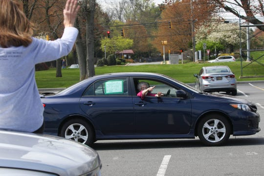 Community members honk and yell from their cars at Brandywine High School to welcome home Veronica McAleer McCrea, who was released from the hospital on Tuesday after recovering from a serious case of COVID-19.