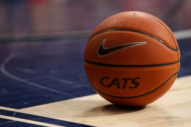 A basketball on the court during a game between the Utah Utes and the Arizona Wildcats at McKale Center.