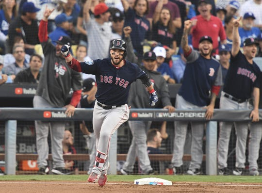 Red Sox first baseman Steve Pearce hits a two-run home run against the Los Angeles Dodgers in the first inning in Game 5 of the 2018 World Series at Dodger Stadium.