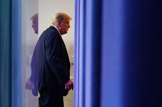 President Donald Trump leaves the White House briefing room on April 13, 2020.