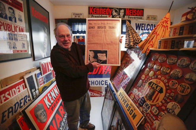 Tom Kitchen poses with his collection in his home in Fond du Lac on Feb. 25.