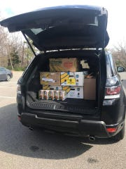 A car trunk packed with donated food in Toms River.