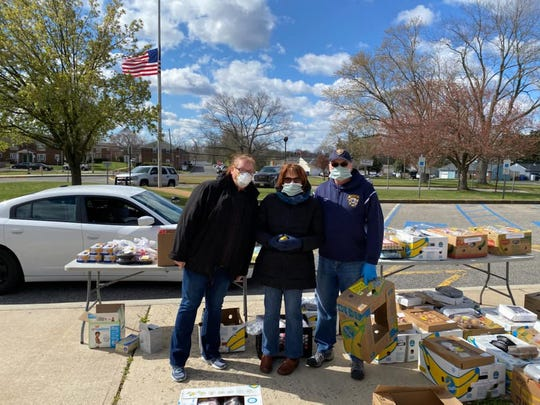 Packing food kits for distribution in Toms River, April 10, 2020.