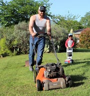 Kyle Phelps had a lot of grass to mow Tuesday evening but he had help. Son Kaysen, 3, followed along with a mower his size. Dad's likely was powered by Briggs & Stratton; Kaysen's mower probably was Fisher Price. Kyle Phelps is employed by AES Wind Generation and set up an office in a travel trailer beside his driveway when he works at home and in case he has to isolate, he said.