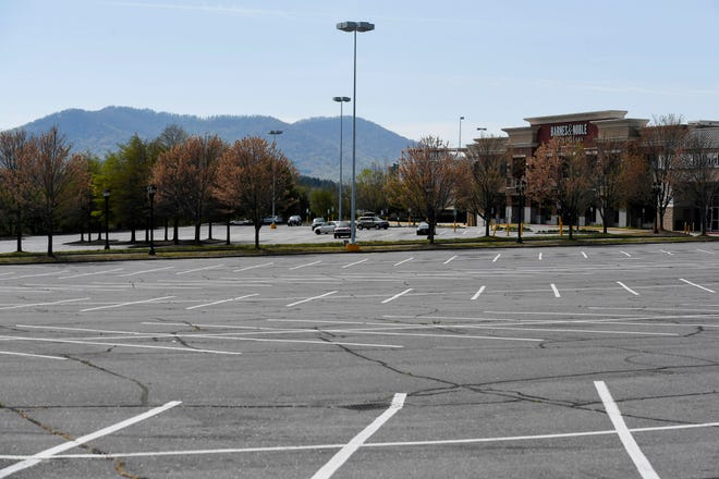A view of the Asheville Mall parking lot April 15, 2020, amidst shut downs due to the COVID-19 pandemic.