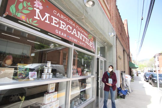 Emily Copus stands outside her Carolina Flowers Mercantile storefront in downtown Marshall.