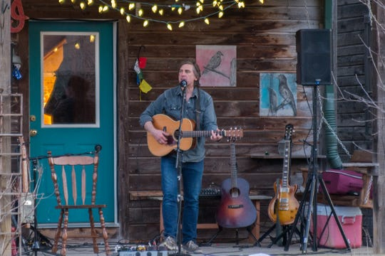 Ithaca-based folk artist Joe Crookston performs on his porch on March 24, 2020. He joins a movement of artists performing on their porches and for live streams.