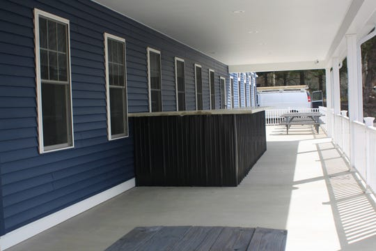 The new Airport Inn Restaurant features an outdoor patio and bar.