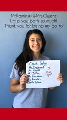 """Abigail Perez, a student at Palm Bay Magnet High, posted a special """"I miss you"""" video for the teachers, coaches and staff there. Perez and 21 other students posed with signs giving Palm Bay High faculty a shoutout during the coronavirus pandemic."""