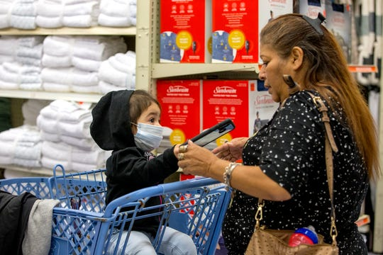 Elsa Martinez, right, shops with her granddaughter, Sophia De La Cruz, 1 1/2, at Ollie's Bargain Outlet on Wednesday, April 15, 2020. The discount retailer had its grand opening on Wednesday.