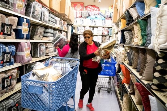 Susie Garcia shops for all things gold for her new home at Ollie's Bargain Outlet opened on Wednesday, April 15, 2020.