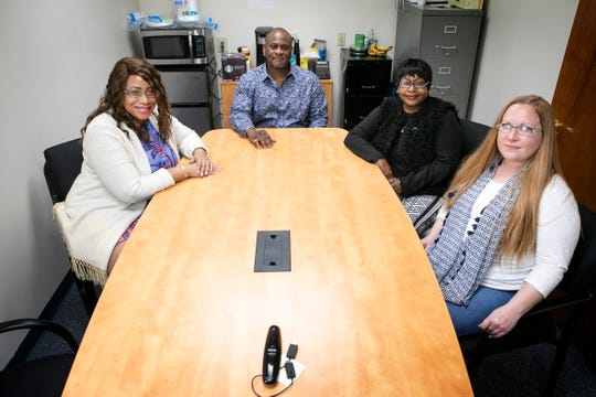 Darlene Parker, Troy Parker, Patricia Chestnut and Brittany Getha, employees of Innovative Labor and Cleaning Services, Inc., photographed inside of the company's St. Bernard office on April 15.