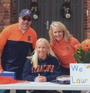 Senior volleyball player Lauren Hogan is signing with Syracuse University, where she will major in exercise science.