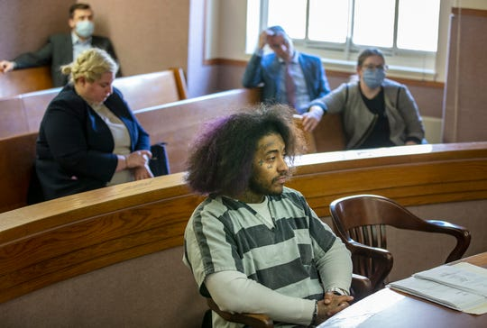 Rashaan Davis, 26, appears in Hamilton County court on Wednesday, April 15, 2020. Judge Alan Triggs dropped charges that alleged Davis violated Ohio's stay-at-home order by recording a large gathering in Over-the-Rhine . An inciting violence charge remains pending until a grand jury can be convened, likely in May. Grand jury proceedings have temporarily been suspended for safety reasons during the pandemic. Triggs released Davis from jail on home arrest.