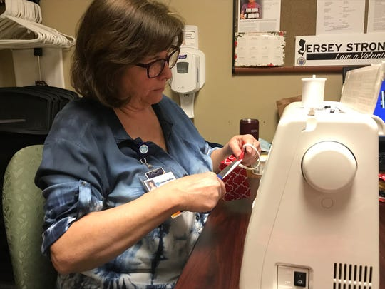 Margaret Grande, office coordinator, Medical Staff Quality and Patient Safety, sews masks at Hunterdon Medical Center.
