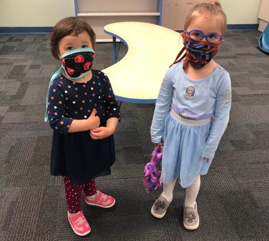 Donning their new masks are Charlotte, left, age 2 and Charlie, age 3. They attend Bright Tomorrows Child Care Center at Hunterdon Medical Center.