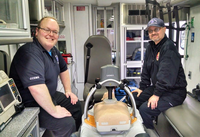 Adam Fisher and Rob Goodwin of the Coshocton County Emergency Services crew at the West Lafayette station with the new LUCAS 3 device purchases through a donation from the Montgomery Foundation.