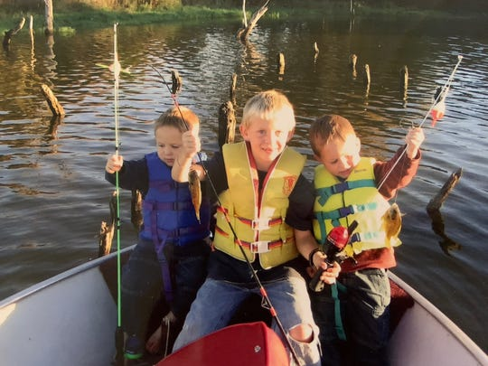 Ben J. Peterson, middle, and his younger twin brothers Josh and John are shown in an undated family photo. Peterson loved fishing, hunting and conservation and shared that passion with those around him, his family said. The 23-year-old died March 31, 2020 after a helicopter he was in crashed in Audubon County while he was doing his job as a field biologist.