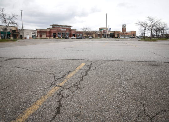 The parking lot is empty at Jordan Creek Mall on Wednesday, April 15, 2020, in West Des Moines.