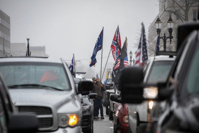 Protesters block traffic around the Michigan State Capitol building in Lansing on April 15, 2020.