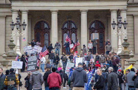 Protesters block traffic while others stood on the steps around the Michigan State Capitol building in Lansing on April 15, 2020, to send a message to Gov. Whitmer that the extension of the Stay at Home mandate, in an attempt to lower the coronavirus infection rate, had gone too far.