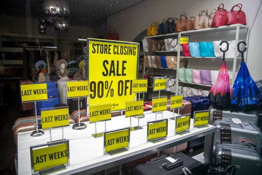 """""""Store Closing"""" sale signs are on display at a shop on Madison Avenue, Thursday, March 19, 2020, in New York."""