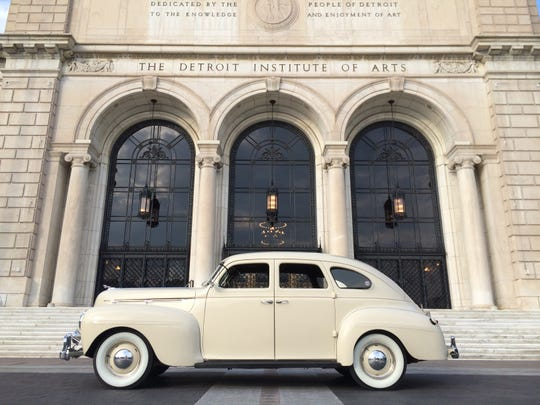 A 1940 Dodge Luxury Liner Deluxe from Chris Beltz's collection in front of the DIA.