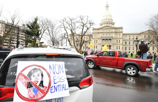 Cars aren't moving on North Capitol Avenue as protesters, from their cars and on foot, surround the state Capitol during Operation Gridlock in Lansing on April 15, 2020.