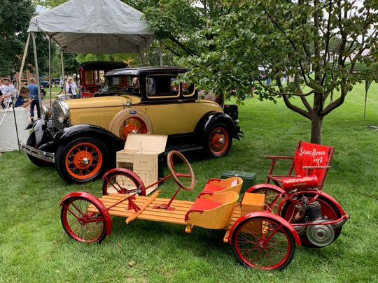 """Chris Beltz """"likes anything unusual and uncommon,"""" he says. Two of his favorites include the 1931 Model A and the 1919 Briggs & Stratton Flyer, seen here at a car show."""
