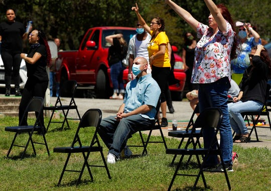 Church goers practice social distancing as they attend an Easter service in the parking lot of Xtreme Harvest Church in San Antonio, Sunday, April 12, 2020. Many churches are adapting their services as Christians around the world are celebrating Easter at a distance due to the COVID-19 pandemic.