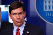 Defense Secretary Mark Esper speaks about the coronavirus. The U.S. military is bracing for a months-long struggle against the virus.