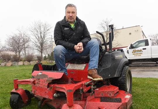 Brien Worrell, owner of Milford-based lawn service company Brien's Services, is eager to get back on his mower after restrictions on lawn services were lifted by Gov. Whitmer on Friday.