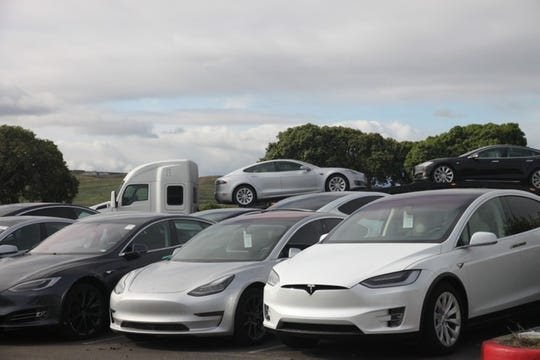 Teslas stack up at a delivery center in Fremont, Calif., on March 24, 2020. (Russ Mitchell/Los Angeles Times/TNS)