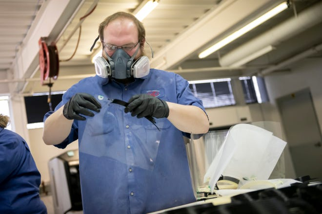 Technician Cory Elsarelli manufactures face shields inside the prototype lab at Mahindra's North American Technical Center in Troy on April 15, 2020. The shields are given to first responders to help provide protection when treating patients with COVID-19.