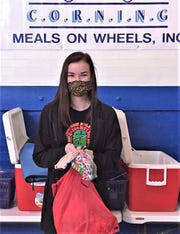 Corning-Painted Post High School senior Angelea Collins shows off some of the face masks she made or collected and donated to Corning Meals on Wheels, among other organizations in response to the coronavirus pandemic.
