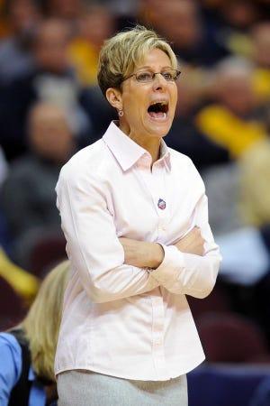Kathi Bennett coaching at Northern Illinois.