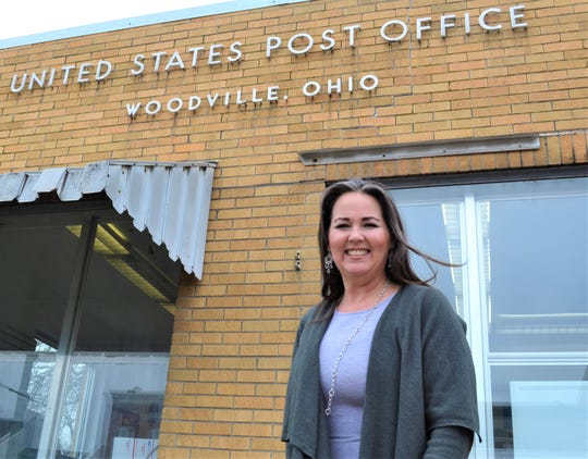 Sarah Susor, who recently published her first book, has been postmaster of the Woodville Post Office for three years. The Woodville Post Office is, she said, the best office she has worked in.