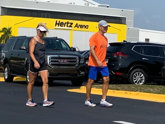 Barb and Pete Martinez of Estero chug past hundreds of rental cars now stored around the Hertz Arena off Ben Hill Griffin Parkway in Estero. Naples businessman David Hoffmann and the Hoffmann Family of Cos., which bought the Everblades hockey team and the Hertz Arena in August, agreed to allow Hertz to store its idle rental cars on the arena grounds a few weeks ago. It's yet another sign of the devastating blow the tourism industry has taken from the pandemic locally, nationally and globally, due to travel bans and other restrictions designed to curb the spread of COVID-19.