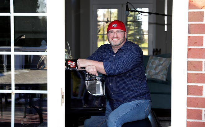 "Dan Rafferty of NEW Piano Guys sits at the piano inside his De Pere home on April 15. With venues closed because of the coronavirus pandemic, Rafferty started livestreaming shows on his ""Play It Again, Dan"" Facebook page three times a week."