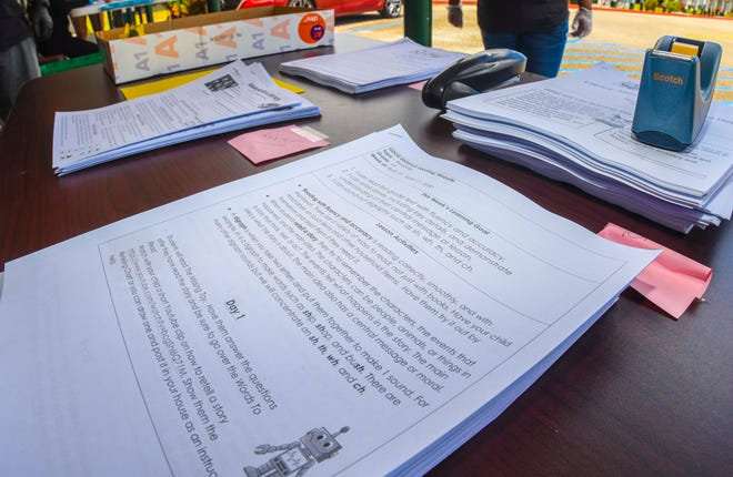Distance learning packets for students of Daniel L. Perez Elementary School in Yigo are shown in this file photo from April.