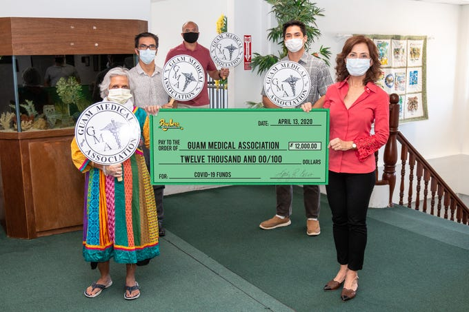 Pay-Less contributed $12,000 to the Guam Medical Association to buy personal protective equipment. From left, Pram Sullivan, Guam Medical Association executive director; Dr. Peter Lombard; Mike Benito, Pay-Less general manager; Kai Akimoto, Guam Medical Association volunteer; and Kathy Calvo, Pay-Less president and CEO.