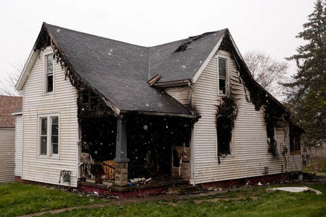 Scorch marks protrude to the exterior of a house on the 1400 block of Grove Street after an early morning fire, Wednesday, April 15, 2020 in Lafayette.
