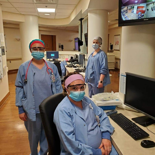 Nurses in the Labor & Delivery Unit at Baptist Health Louisville demonstrate the amount of PPE worn in the hospital at all times.